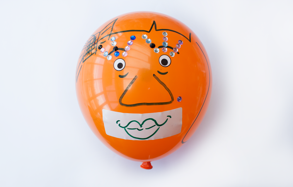Draw a mouth on the label and stick it to the balloon. That's it you're done! Well done.