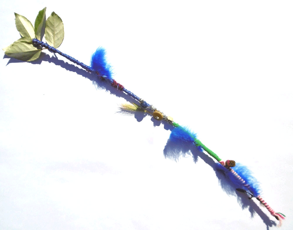 To decorate your stick, wrap wool, fabric and pipe cleaners around your stick.