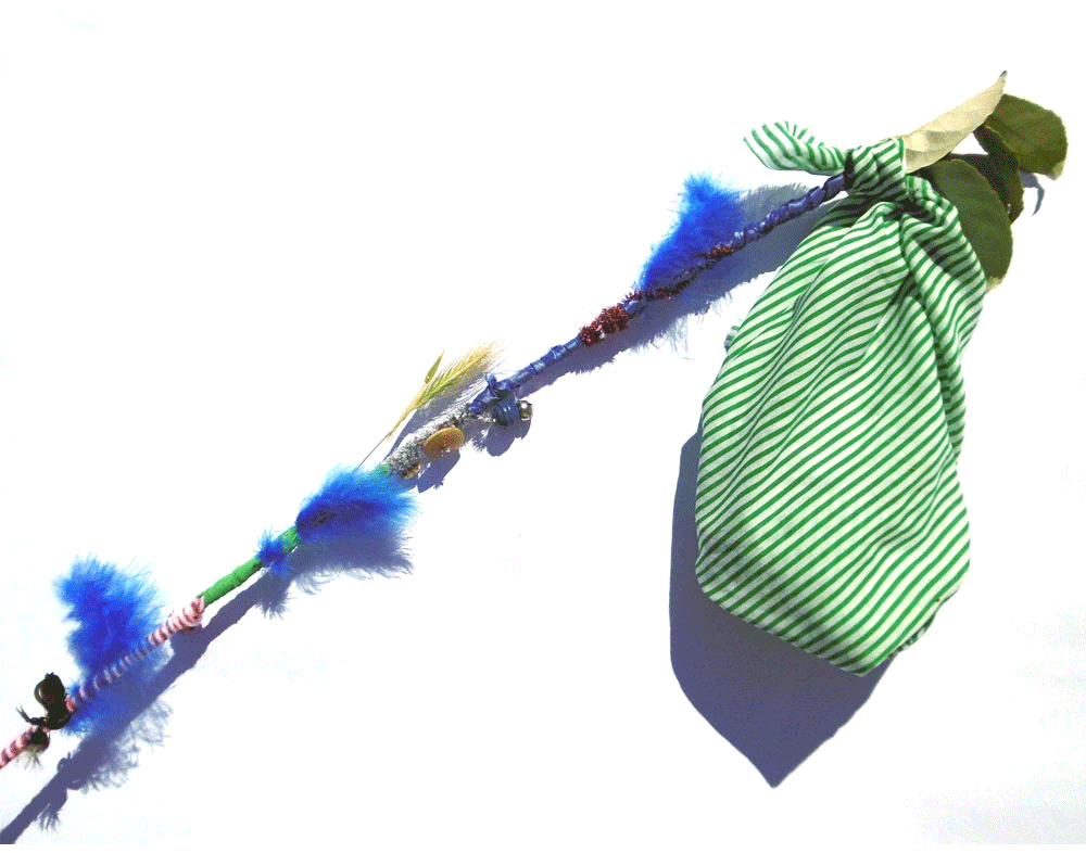Tie one of the corners of the fabric on your stick then knot the remaining corners into a bag. Use your bag to collect sticks, leaves, flowers and bark for your nature table.