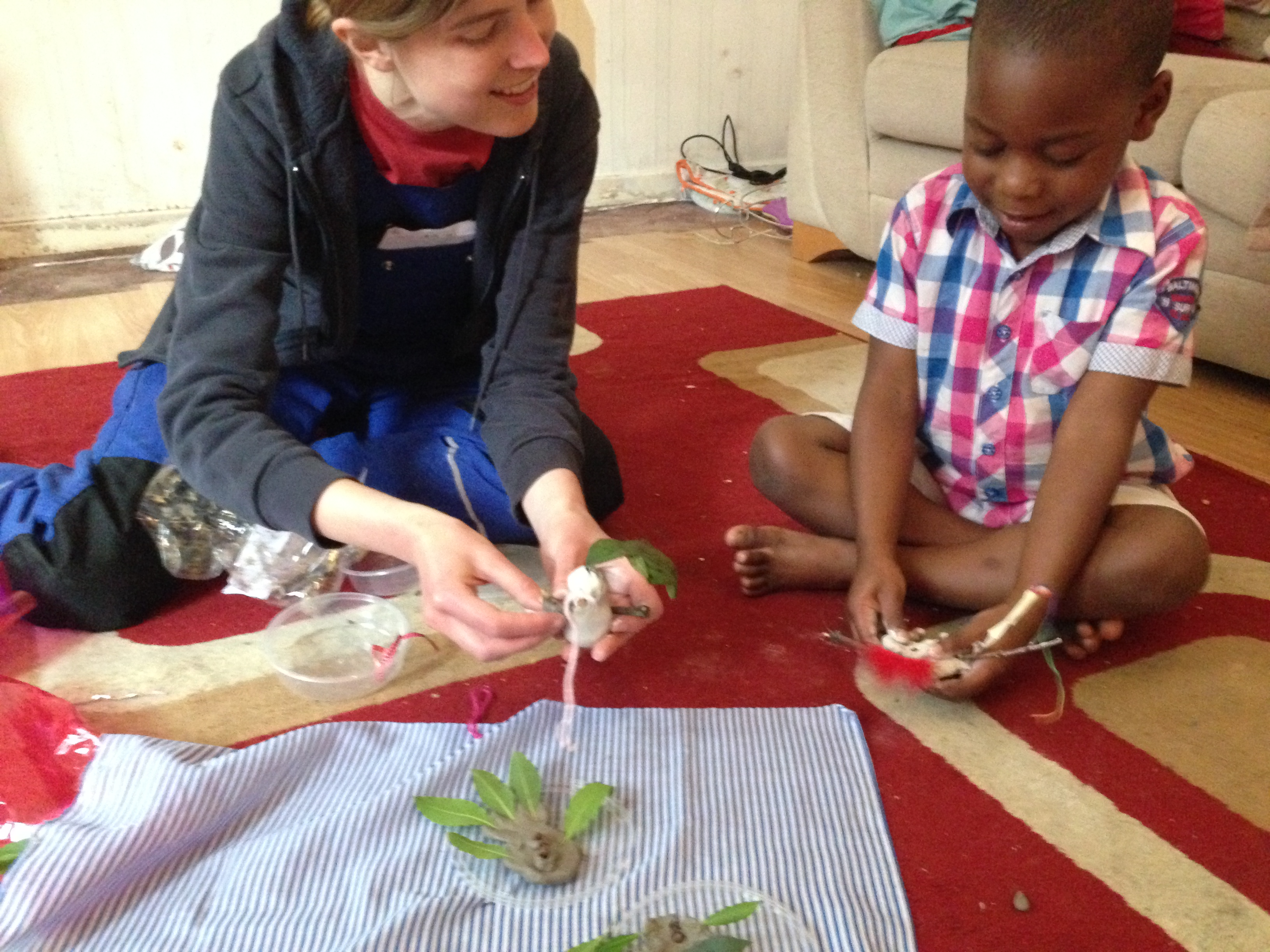 Using leaves, twigs and clay to add to our Nature Table.